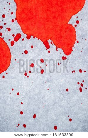 Blood stains on white paper abstract background for violence murder or crime scene