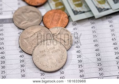 Utility bill with us coin and dollar banknotes.