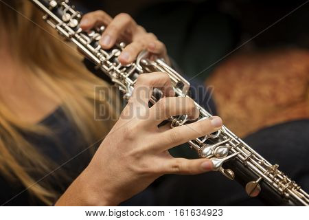 Close Up Shot Of Hands Playing Oboe