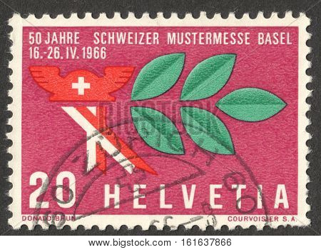 MOSCOW RUSSIA - CIRCA NOVEMBER 2016: a post stamp printed in SWITZERLAND shows a Mercury hat and laurel branch dedicated to the Swiss Sample Fair circa 1966