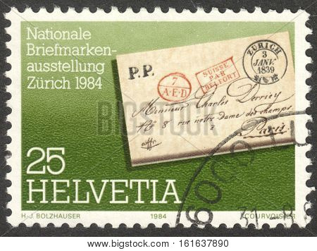 MOSCOW RUSSIA - CIRCA NOVEMBER 2016: a post stamp printed in SWITZERLAND shows a pre-philatelistic letter circa 1984