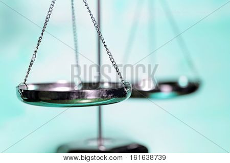 Scale of justice with blue background (Concept of Justice)