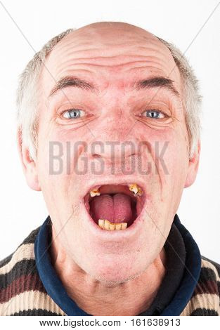 Portrait of elderly man with an open toothless mouth