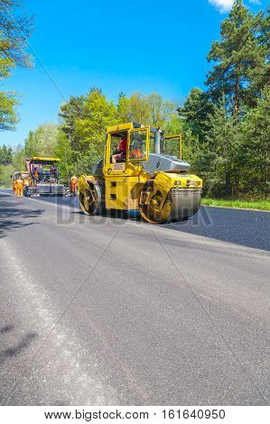 CZECH REPUBLIC, PLZEN,7 MAY, 2016:Asphalt spreading machine and vibration roller  at pavement road works.