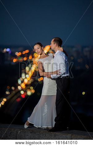 Bride and groom on the background of the city at night