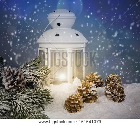 Christmas decoration with white lantern,gold cones and snowflakes