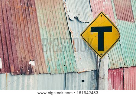 Dead End Warning Sign On Old Metal Texture Background.