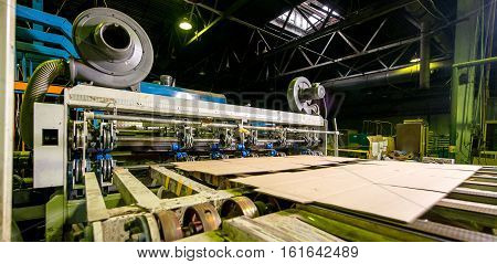 At a paper mill factory. Processing paper.