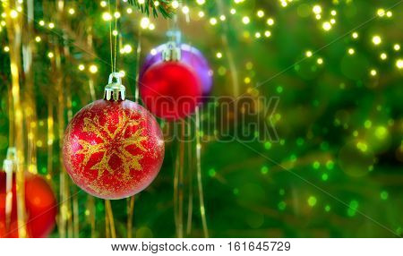 Christmas Fir Tree Branches and decoration with luminous lights. Christmas background.