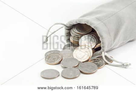Financial saving and coins background concept - Close up thai 5 baht coins in gray bag coins overflow with copyspace