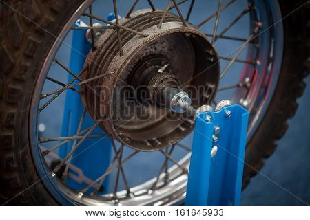Close up shot of a motorcycle wheel with spokes.