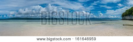 Beach on Kri Island, Gam in Background, Raja Ampat, Indonesia, West Papua. Banner