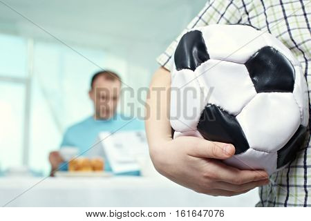 Close-up of childish hand holding deflated ball