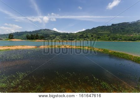The Castlereigh Dam is a gravity dam built across the Kehelgamu Oya, a major tributary to the Kelani River, approximately 3 km south-west of Hatton, in the Central Province of Sri Lanka.