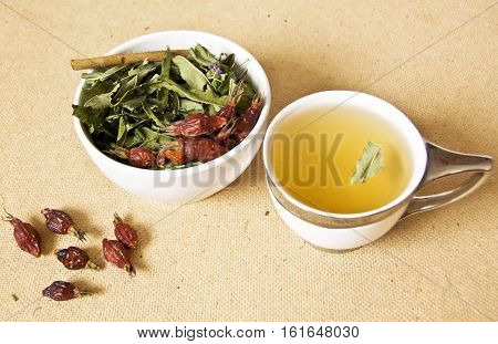 Green tea with wild roses and willow leaves angustifolia