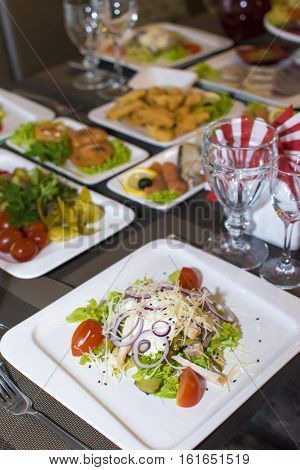 Healthy green organic Caesar salad with croutons and cheese on a festive table
