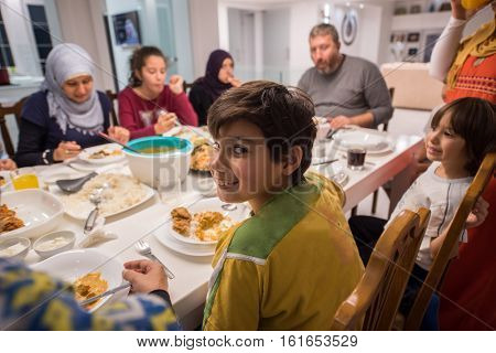 Muslim traditional family together having dinner on table at home
