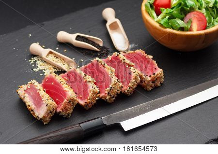Rilled Tuna Fillet With Sesame On A Stone Plate.