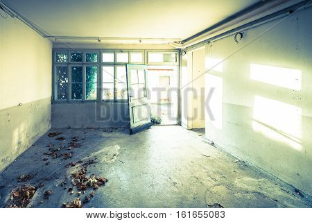 Old abandoned house. The room is destroyed the walls are broken trash on the floor chaos. Аbstract