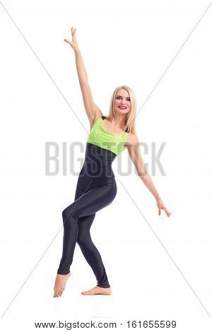 Fit girl. Attractive young cheerful blonde female aerobics instructor posing gracefully on white background