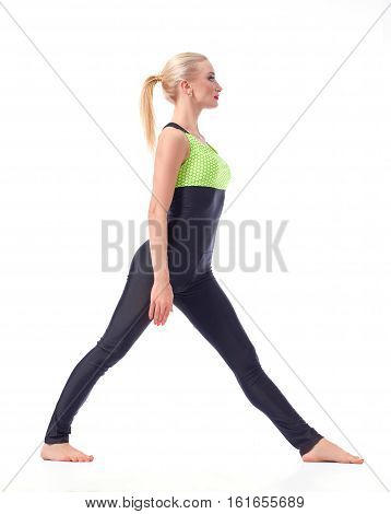 Focused on fitness. Full length studio shot of a female gymnast preparing to do splits posing isolated on white sports gymnastics fitness concept