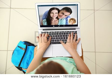 Video call and chat concept. Boy video conferencing on laptop