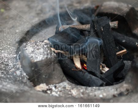 COLOR PHOTO OF CHARCOAL FIRE IN STOVE