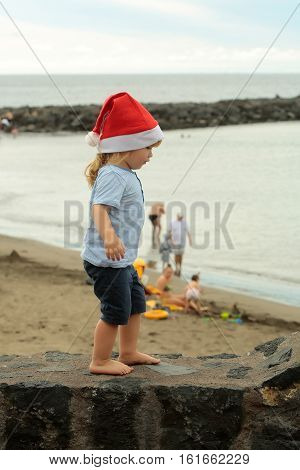 Santa Boy Near Water Outdoor