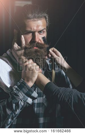 Female Hands Shave Bearded Man