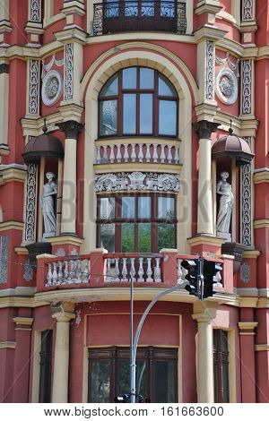 Open renovated house with statues girls. Kyiv.