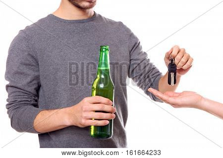 Close up view of drunk man giving car key to woman, on white background. Don't drink and drive concept
