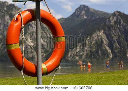 Red lifebuoy hang by mountain lake Traunsee Salzkammergut Upper Austria