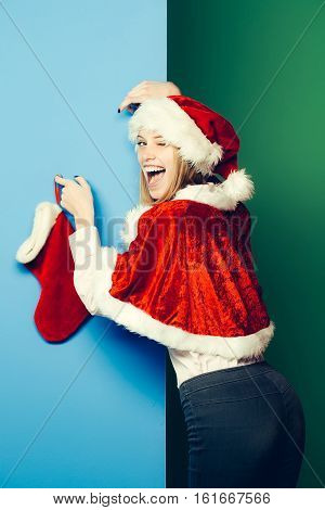 Winking Girl With Christmas Sock