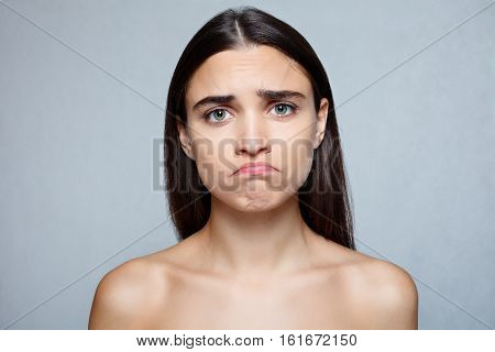 people luxury and fashion emotions concept - Portrait of young woman with shocked expression of sadness