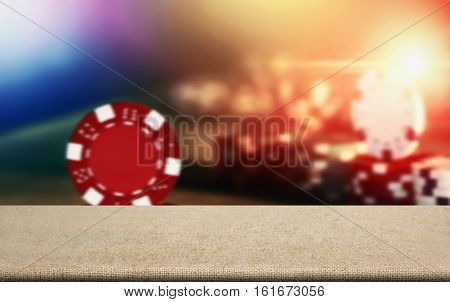 Sack Tabletop With Blurry Poker Chips On Table In Casino For Montage Architect Product Advertising.