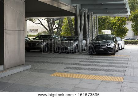 Singapore - 01 November 2014: Premium cars on parking in the city at daytime