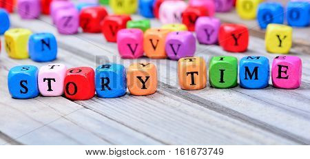 Story time words on grey wooden table