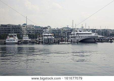 Singapore - 01 November 2014: Caribbean at keppel bay. Moored yachts in luxury residential in city