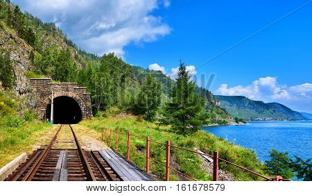Tunnel railway near Lake Baikal and bridge in foreground. Irkutsk region. Russia