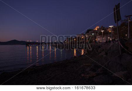 Anguillara pier over Bracciano Lake at night, Italy