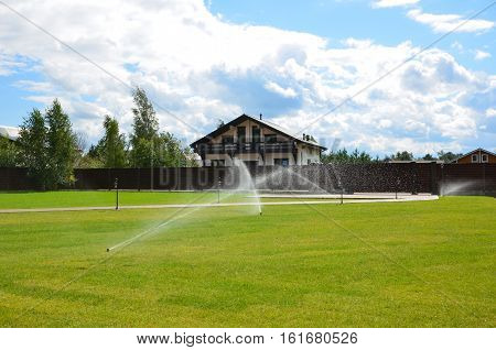 Automatic watering of the lawn. Country house.