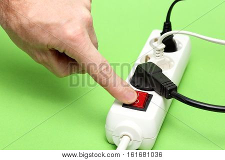 multiple- socket with plugs on a green background