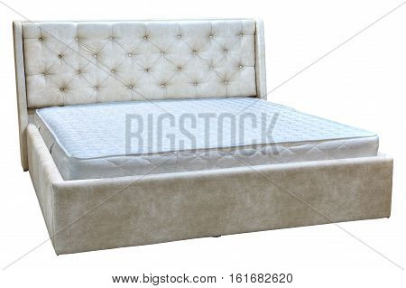 Wooden double bed with cream faux leather and orthopedic mattresses.