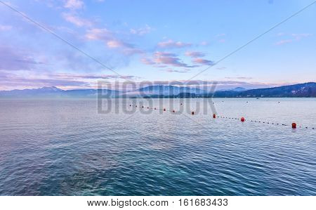 Lake Attersee In The Morning With Buoys On The Water
