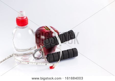Bottle of water apple handgrip and tailoring tape fitness concept