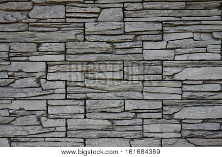 view of a wall comprising a plurality of parts made of stone