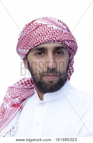 Young smiling handsome arabian man wearing traditional clothes isolated on white