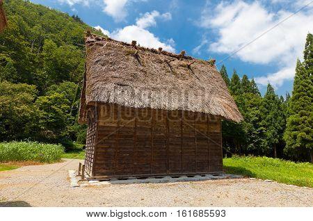 OGIMACI JAPAN - AUGUST 01 2016: Storage shed of Takeda Seijiro House (circa 19th c.) in Ogimachi gassho style village of Shirakawa-go district. World Heritage Site of UNESCO