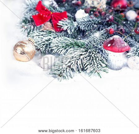 Snowy Christmas decoration with gold christmas ball