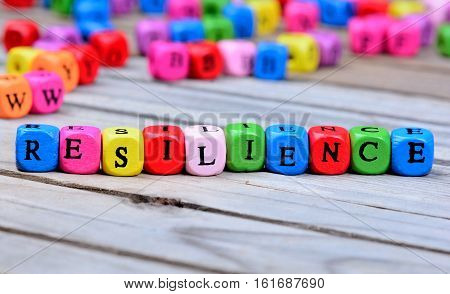 Resilience word on wooden table close up